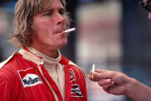 James hunt smoking a cigarette whilst being offered another