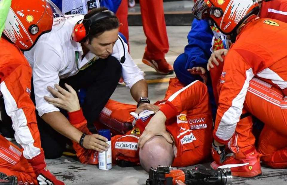 Ferrari mechanic rolling around in great distress