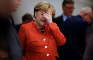 Angela Merkel slaps herself in the face