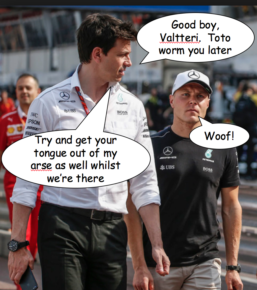 Toto Wolff walking with Mercedes GP driver Valtteri Bottas