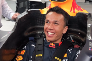 Alex Albon sits in Red Bull 2019 F1 car